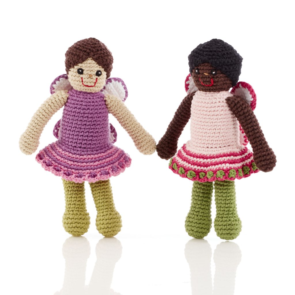 Two handmade crochet fairy dolls, one black and one white.